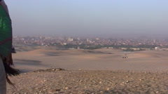 Desert Camels Next to Pyramids of Giza - stock footage