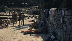 Stock Video Footage of Yugoslavia 1984: people sunbathing on the beach