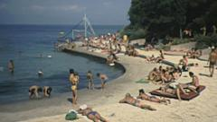 Yugoslavia 1984: people sunbathing on the beach - stock footage