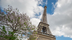 The Eiffel Tower in Paris time lapse, high section Stock Footage