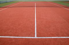 Stock Photo of Tennis ball on court grass play game background sport for design