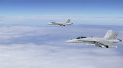 Two F-18 Fighter Jets Cruising Above the Clouds Stock Footage