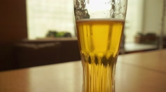 Glass beer on wood background with copyspace Stock Footage