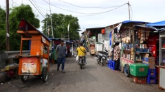 Walk through slum street on Sunter river bank, ghetto of Jakara city. Stock Footage