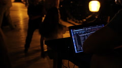 DJ and dancers at night Stock Footage