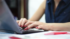 Woman hands typing on a laptop Stock Footage