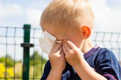 Stock Photo of crying unhappy little boy wiping his eyes