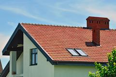 Roof of the house with attic - stock photo