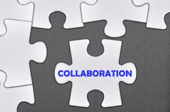 jigsaw puzzle written word collaboration - stock photo