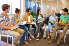 Attentive creative business people in meeting - stock photo