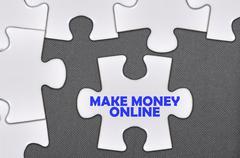 jigsaw puzzle written word make money online - stock photo
