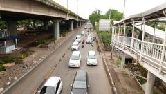 Traffic on Yos Sudarso road, move by overpass, carriageway perspective, people Stock Footage