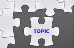 jigsaw puzzle written word topic - stock photo