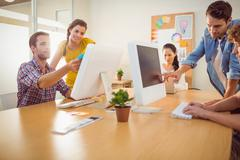 Attentive business team working on laptops - stock photo