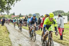The Peloton on a Cobbled Road- Tour de France 2014 - stock photo