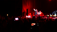 Cheering spectators shooting video of singer on rock concert via phone tablet Stock Footage
