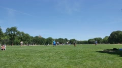 People Relax and Play Ball on the Great Lawn of Central Park Stock Footage