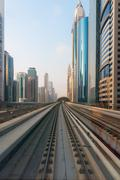 Ultra Modern Architecture of Dubai from the Metropolitan Transit Rails - stock photo