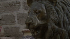 Sculpture of a lion at the entrance to the monastery Stock Footage