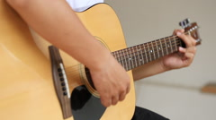 Hand playing acoustic guitar Stock Footage