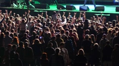 Cheering spectators audience clapping hands up in air on rock concert - stock footage