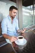 Attentive businessman using a tablet Stock Photos