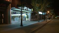 late night small town main street pan - stock footage