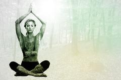 Stock Illustration of Composite image of calm blonde meditating in lotus pose with arms raised