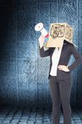 Stock Photo of Composite image of anonymous businesswoman holding a megaphone