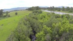 Flight over river and Kelly island in Missoula Montana Stock Footage