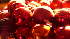 Shiny red and gold Christmas ball mistletoe ornaments in morning new year light Stock Footage