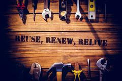 Reuse, renew, relive against desk with tools - stock photo