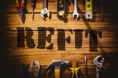 Refit against desk with tools - stock photo