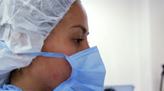 CLOSE UP. Nurse face during surgery. Stock Footage