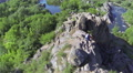 Flight around  girl hiker tourist standing on rock and river .Aerial HD Footage