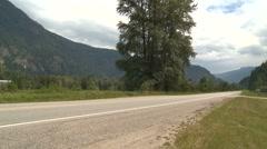 Transportation, 2 motorbikes pass on empty highway Stock Footage
