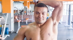 Cute heavy-weight sportsman is exercising with dumbbell Stock Footage
