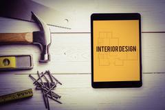 Interior design against blueprint - stock photo