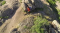 Girl  hiker tourist goes  up on mountain footpath. Aerial top  Footage