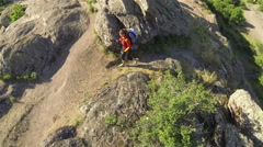 Girl  hiker tourist goes  up on mountain footpath. Aerial top  Stock Footage