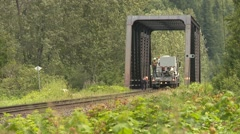 Railroad, work crew at bridge on Hi-railer, lush green forest, Stock Footage