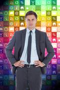 Stock Illustration of Composite image of serious businessman with hands on hips