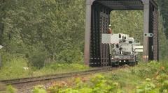Railroad, work crew at bridge extending boom from work hi-railer Stock Footage