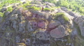 Slow fly over woman  hiker tourist  standing on  hill top. Aerial  Footage