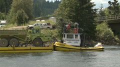 Lake barge and tug with construction equipment, medium shot, Stock Footage