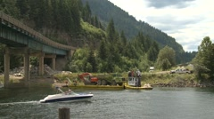 Lake barge and tug with construction equipment, wide shot, Stock Footage