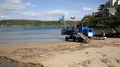 Sea tractor enters the water South Sands beach Salcombe Devon Stock Footage