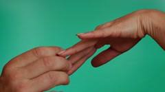 Man puts the ring to womans finger close up chroma key Stock Footage