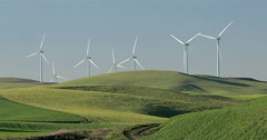 Wind turbine electric power generator in the field - stock footage