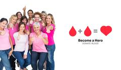 Composite image of voluntary cheerful women wearing pink for breast cancer Piirros